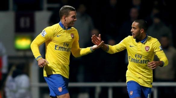 Goal Scorers Podolski and Walcott