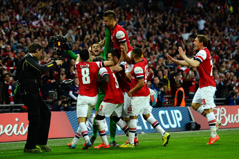 Penalty Shoot-out Hero Fabianski Is Mobbed By Teammates