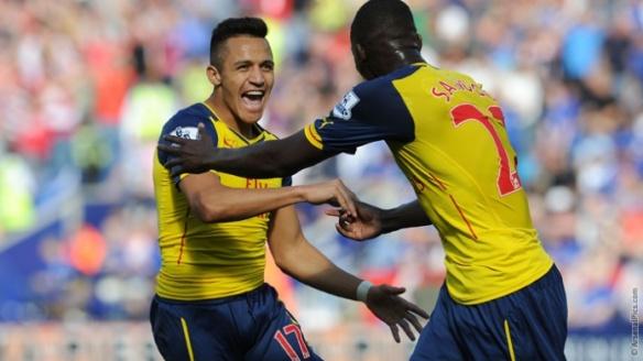 Alexis Sanchez celebrates his first Premier League goal