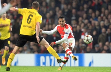 Alexis curls home a wonderful effort against Dortmund