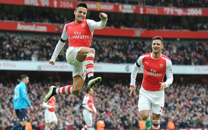 Alexis celebrates his first of two goals against Stoke