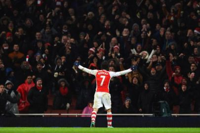 Rosicky celebrates his winner against QPR