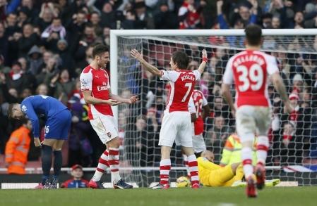 Goalscorers Giroud and Rosicky celebrate Little Mozart's strike